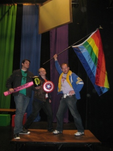 Is Patrick a Super Intern? Balancing a TYA/USA internship with a fellowship at the Omaha Theater Company? Or is he posing with co-directors of Pride Players 14 after a gay themed parody of the Avengers?