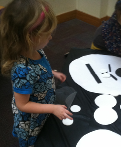 A young audience member engages in art-making