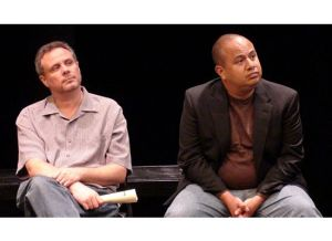 "David Montgomery and playwright Ramon Esquivel listening to an audience member's question during the talkback for ""Nasty"""