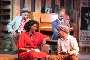 "Clockwise from bottom left: Eboni Fondren (as Miss Thomas), Granvile T. O'Neal (as Mr. Jimmy), Elijah E. Murray (as Steady Eddie), and Aaron Branch (as Bud ""not Buddy"" Caldwell) in Bud, Not Buddy. Photo by J. Robert Schraeder and courtesy of Coterie Theatre."
