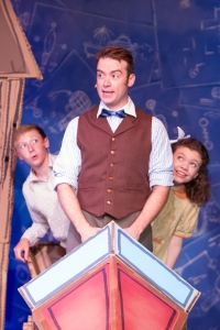 Left to right: Lucas Dorrell (as Jeremy Potts), Jake Walker (as Caractacus Potts), and Allison Banks (as Jemima Potts) in Chitty Chitty Bang Bang. Photo by J. Robert Schraeder and courtesy of The Coterie Theatre.