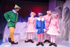 Jake Walker (as Boss Elf™) and Zoe London, Cam Burns, Maddie Bruegger, and Hannah Thompson (as Elves) in The Coterie's production of Rudolph the Red-Nosed Reindeer: The Musical, running November 4, 2014 – January 4, 2015. Photo by J. Robert Schraeder and courtesy of The Coterie Theatre. Rudolph the Red-Nosed Reindeer ® The Rudolph Co., L.P. All elements under license to Character Arts, LLC. All rights reserved.